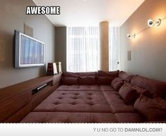 idea for total awesomness... turn an extra room into a theater with a custom padded floor turned gigantic couch room!! AMAZING!