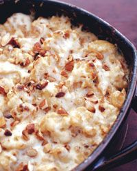 Cauliflower Gratin with Manchego and Almond Sauce:   Contributed by Grace Parisi  This outrageously rich sauce, flavored with salty, nutty Manchego, gets poured on sautéed cauliflower and baked until it's golden and bubbling [click for recipe]