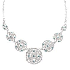 Blue topaz elegance!A delicate, silvertone collar necklace with round filigree medallions embellished with blue topaz colored stones.Introducing Signature Collection:Effortless style that's totally wearable. Pieces that flatter your shape and fit in comfortably with your lifestyle. That's the heart of Avon's Signature Collection. Designed by Avon. Inspired by you. Meet your new favorite label.Ultimate Challenger Collection: Blue topaz-colored stones adorn this silvertone filigree...