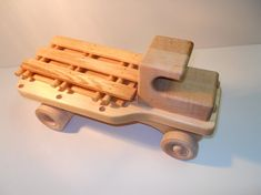 These stake trucks are handmade from Michigan hardwoods, and have a coating of filtered walnut oil on them (food-grade oil). There are also no nails or screws that go into crafting them. Everything that goes into this product is totally safe for children. The sides are also