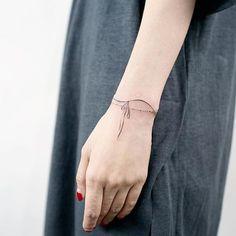 @tattooist_doy • #bracelettattoo #daintytattoo #wristtattoo