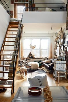 This staircase in the middle of a chic little urban loft looks so inviting and beautiful - we are waiting on our invite!