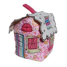 Fairy house doorstop from Sparrow Couture for Kids. Like the arched window