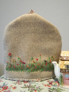 lambs wool felt embroidered tea cosy by madebybeaonline on Etsy, £35.00