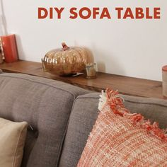 DIY Sofa Table Adds Much-Needed Storage Behind A Couch  could change spindle legs to iron pipes