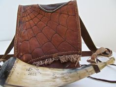 Antique Authentic Handmade American Early 1900s Leather Hunting Bag With Hand Primitive Naive Folk Art Scrimshawed (Carved) Powder Horn. $350.00, via Etsy.