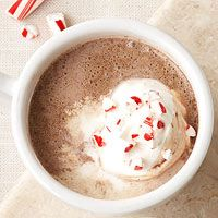 Insane Candy Cane Slow Cooker Cocoa - capture the spirit of the holidays by stirring peppermint extract into homemade hot chocolate. Don't forget to garnish with crushed candy cane!