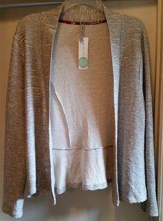May 2016 Stitch Fix SWEET GREY Jafar Peplum Back Cardigan (Light Grey) https://www.stitchfix.com/referral/7826598 #StitchFix #SweetGrey - There are a couple of ruffles on the lower back.