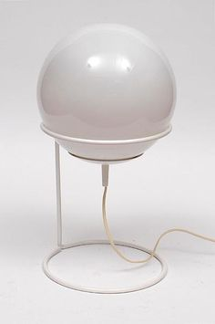 White lackered metal table-lamp Basket with white glass lamp ball designer unknown executed by Hala Zeist / the Netherlands ca.1970