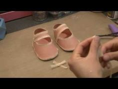 Paper baby shoe papercraft tutorial, via YouTube.