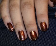 Inspired by Catching Fire (Hunger Games). I went for the Glowing ember effect described in the book. Wish this is a better pic because it is super sparkly in person and mimics the glowing embers inside the fire. Love it. Hunger Games Nail Art