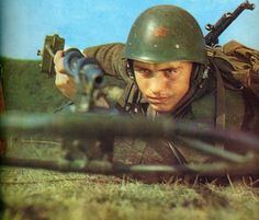 Albanian soldier operating a mine detector.
