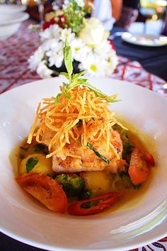 Ikan Kuah Kemangi: Coconut milk, turmeric and other ingredients were mixed in a saucepan to create the savory soup. (Pho...