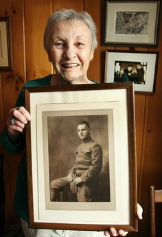 Jane Scanlon is the daughter of a Weymouth man,  George MacKenzie,who was the last survivor of the Yankee Division. Scanlon holds a photo of her father,Tuesday, March 28, 2017. Gary Higgins/The Patriot Ledger
