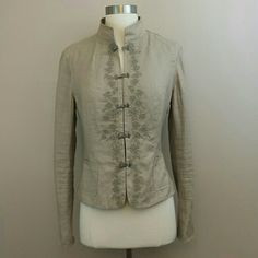 Tahari embroidered linen blazer w/ mandarin collar Gorgeous tan linen blazer with a mandarin collar.  Metal fasteners up to the top.  Floral embroidery design down the front.  Full length sleeves.  Blazer is fully lined.  100% linen Elie Tahari Jackets & Coats Blazers
