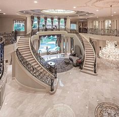 double stair case marble home