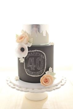 A double barrel tier on the bottom decorated in chalkboard style. The top tier was decorated using Shawna McGreevys method of applying silvervleaf antique style. Decorated with sugar flowers and a rice paper anemone. Special Birthday Cakes, Adult Birthday Cakes, Pretty Cakes, Beautiful Cakes, Chalkboard Cake, Chalkboard Wedding, Black Wedding Cakes, Cake Wedding, Different Cakes