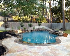 in-ground swimming pool with stamped concrete pool deck