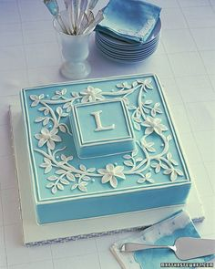 Letters found in vintage books or print shops can inspire beautiful cakes. This royal-icing monogram is surrounded by a rolled-fondant flower garland on the background color of your choice.