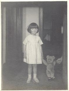 Young girl with teddy wearing shoes