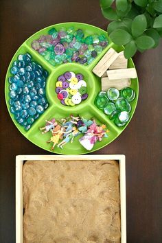 Invitation to create a fairy garden with golden dough, glass gems, driftwood and fairies!