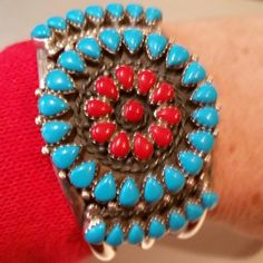 "Vintage 70's ZUNI Turquoise/Coral Sterling Cuff Petit Point Turquoise and Coral stones, Solid Sterling Silver and it is marked, at widest point on the top of cuff is 2""  Heavy cuff 64 grams, opening is 3/4""  This Bracelet is for a 6"" or 7"" wrist. I have very small wrist and it fits perfect. Vintage Jewelry"