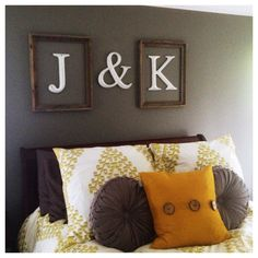 Initials framed above bed. The funny thing is that these are my parents initials in the correct spots
