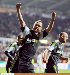 Charlie Adam celebrates netting a stoppage time equaliser at Swansea