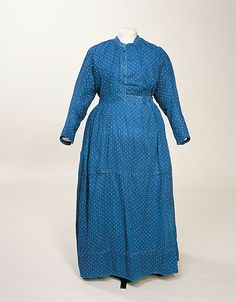 """Maid's Dress: 1880-1900, printed cotton, bodice lined in plain cotton, """"Much worn, altered and mended."""" """"Label written by donor: 'Belonged to Magaret Robb of Castle Douglas, Scotland, she was in service at my Great Grandfather's house, William Bradshaw, Slade House, Levenshulme, afterwards Slade House, Bowdon, from the age of 17 yrs., she never left the family and died at my Aunt's house in Bickley, Kent at the age of 82 yrs, much loved by all,'"""""""