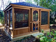 This gazebo features a low knee wall and large screened walls providing wonderful visibility to the beautiful surroundings. Screens also protect homeowners from mosquitoes and other insects which is crucial in a tree-filled yard such as this one. The rectangular shape was chosen because of its modern appearance and because it comfortably fits a dining table.