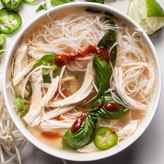 An easy quick chicken pho recipe. You will need rice vermicelli noodles, a rotisserie chicken, chicken broth, basil, mung bean sprouts, and Sriracha.