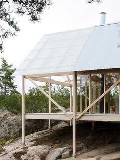 Swedish studio Arrhov Frick Arkitektkontor used slender stilts to elevate this timber-framed cabin on an island in the Stockholm archipelago.