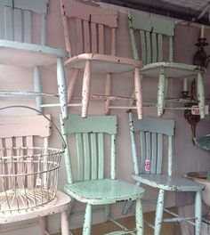 "I should take all the chairs I have hanging on my garage waiting to ""be something,"" paint them in pastels, and hang them on the walls of my booth!"