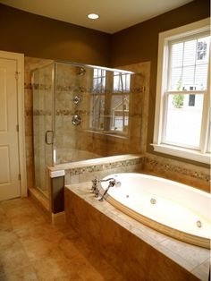 Master bathroom with glass shower enclosure.