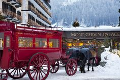 Mont Cervin Palace in Zermatt greets its guests at the nearby train station with its renowned red horse-drawn carriage.