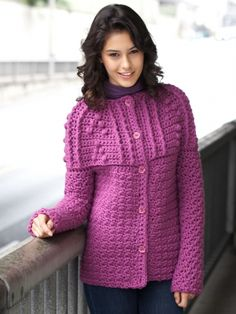 An elegant textured yoke adds sophistication to this pretty cardigan. Shown in Bernat Softee Chunky. #crochet #cardigan #orchid