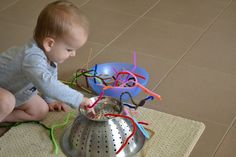 Montessori toddler activities: Threading activity with pipe cleaners and upside-down colander  Or whatever he decides to do with them.