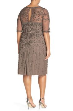 Free shipping and returns on Adrianna Papell Beaded Cocktail Dress (Plus Size) at Nordstrom.com. Gorgeous garden-inspired beadwork brings glamorous shimmer and dimension to a lovely cocktail dress with an illusion sweetheart neckline and elbow sleeves. The style flatters with a fitted waist and slim, straight skirt.