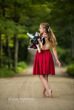 Teen girl wearing red dress walks down country road with a collection of shoes thrown over her shoulder. Photo by Steve Holmes Photography Dance Senior Portraits, Dance Senior Pictures, Dance Picture Poses, Unique Senior Pictures, Senior Photos Girls, Dance Poses, Girl Pictures, Senior Pics, Outdoor Dance Photography