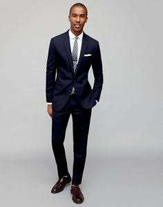 Classic Style: J.Crew's navy suit is front and center with an essential white dress shirt and blue patterned tie.