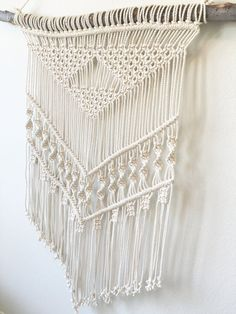 MADE TO ORDER--please allow 5-7 business days production time Created with 100% cotton, 3/16 twisted rope, this handmade wall hanging macrame piece is perfect for any room in your home! Dimensions: -wood piece: 41 in (104 cm) -macrame width: 27 in (68 cm) -macrame length: 47 in (119 cm) Looking for a different size? Message me about your custom order, I would love to create a piece just for you! Thanks for stopping by
