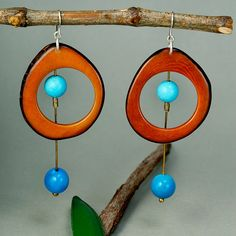 Chunky tagua earrings with brown slices and turquoise stone - sterling silver hook and clasps  These exceptional earrings add color to your outfit. They work brilliantly with black, brown, navy blue, white and denim.  • Height of earrings: 3.14 in – (8 cms) , including hook. • Width of earrings : 1.37 in - (3.5 cms) • Brass wire • Natural beads and semi precious stones: brown tagua nut slices, turquoise sphere tagua nut and turquoise stone. • Sterling silver hook and clasps Tagua is also…