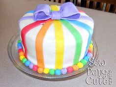 I want to make this for my daughters birthday. She will love the rainbow cake inside!! Thanks Tam @ Sew Dang Cute Crafts for the great Idea.