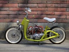 Custom vintage v-twin scooter with leading link fork, metallic chartreuse paint and white bicycle seat