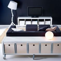 Add Ikea casters for an industrial look, like this expedit turned sofa table.