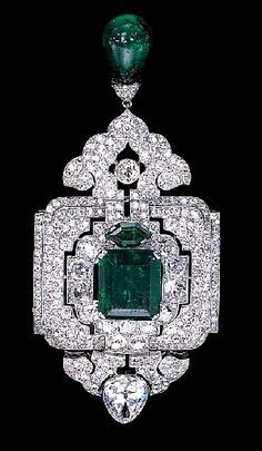 An impressive emerald and diamond pendant-brooch, by Cartier, year 1998.