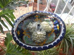 The fountain I created for my balcony in Puerto Vallarta, Mexico.  One old/new Mexican style sink--a plastic drain stopper---a metal plant stand from Home Depot---also a water pump with fountain attachments from HD---three large pieces of bleached coral!  Add water---maybe a goldfish or two---beautiful with a nice sound of bubbling water.