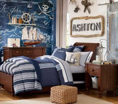 white and blue striped bedding, rope plaque, and huge ocean map -- nautical sea ocean pirate