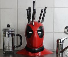 There's no question about how much we all loved Deadpool. So, why not add some Deadpool knife block to you kitchen? We guarantee this is probably the best knife block we've ever seen. Geek Decor, Dead Pool, Geek Culture, Knife Holder, Tv Holder, Geek Gadgets, Knife Block, Kitchen Gadgets, Kitchen Tools