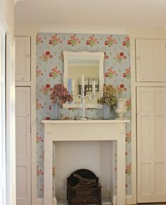 Entryway in English home with Cath Kidston wallpaper